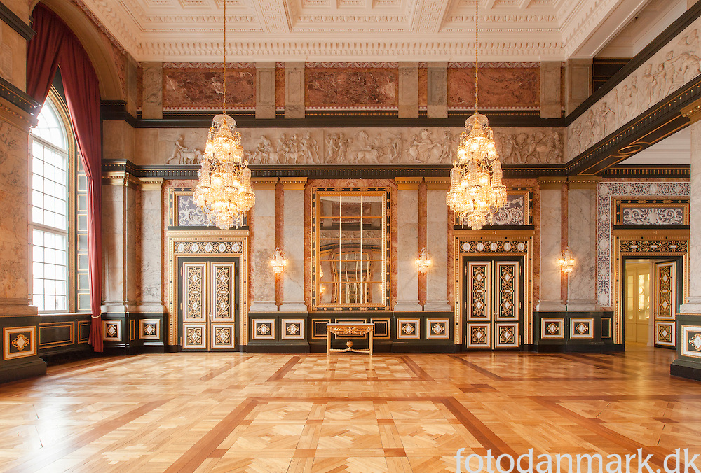 "The Alexander Hall (Alexandersalen) is named for Bertel Thorvaldsen's marble frieze ""Alexander the Great Enters Babylon"". The frieze was made for the second Christiansborg Palace, and parts of it survived the fire. It was later restored and mounted in this room. The Hall is used for smaller receptions and official dinners, often in connection with state visits."