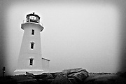 Peggy's Point Lighthouse is often surrounded by fog - 101 days a year on average, Peggy's Cove, Halifax, Nova Scotia.