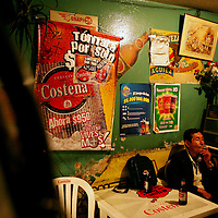 A man has a beer in a bar in barrio Ciudad Bolivar in southern Bogotá on Saturday, September 23, 2006. Bars like these play corridos prohibidos, accordion-laced, hard-driving ballads about Colombia's underworld that are popular in many parts of Colombia. (Photo/Scott Dalton)