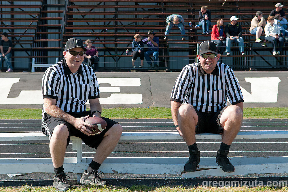 Officials Calvin Hiatt and Keith Porter before the start of the Vale LaGrande youth football game October 19, 2013 at Vale High School, Vale, Oregon LaGrande won the game 32-7.
