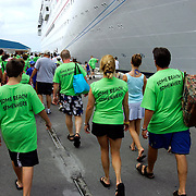 Tourists  walking back to cruise ships after leaving Bahamas Customs in Downtown Nassau in The Bahamas.