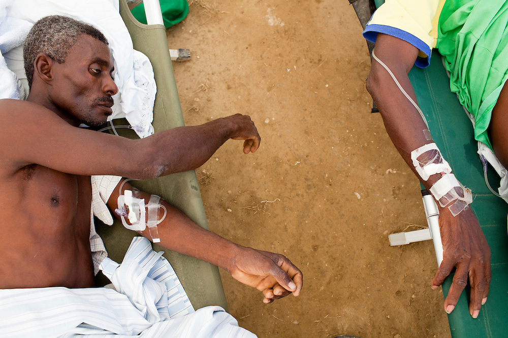 Emanuel Donival, left, and Genio Borcelus, right, are treated for cholera at a clinic on Friday, November 26, 2010 in Cabaret, Haiti.