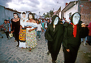 MEXICO, FESTIVALS, DAYS OF THE DEAD Masked figures doing the 'Danza de Muerto' or 'Dance of Death' in Mitla near Oaxaca at dusk on Nov. 3rd
