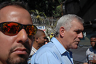 A bodyguard accompanies wealthy Haitian businessman and Haitian presidential candidate Charles Henry Baker, during a campaign event organized by the Group 184. Port-au-Prince, Haiti, January 16, 2006.