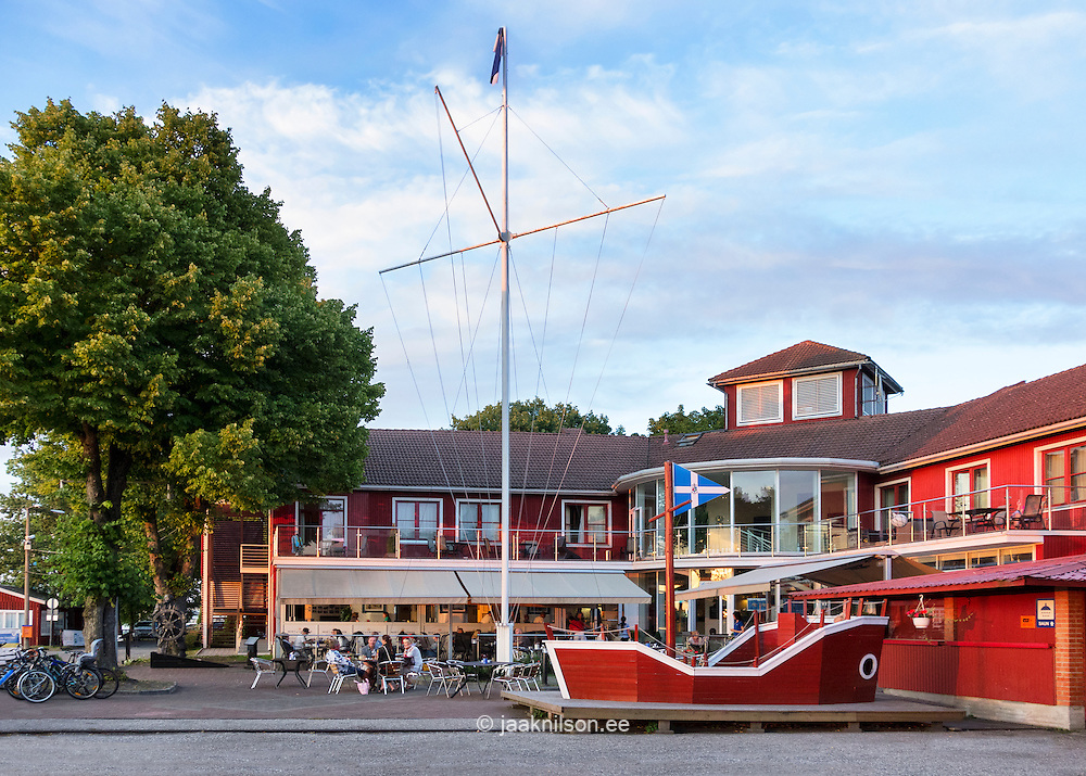 Wooden red painted open-air cafe or restaurant Jahtsadam in Pärnu, Estonia. Yacht club restaurant, hotel or quest house.