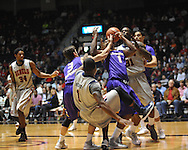 "Ole Miss' Martavious Newby (1), Ole Miss' Murphy Holloway (31), Lipscomb's Carter sanderson (3), and Lipscomb's Malcolm Smith (1) go for the ball at the CM. ""Tad"" Smith Coliseum in Oxford, Miss. on Friday, November 23, 2012."