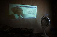 Syria. A Syrian man watch news on Al Jazeera channel into a media-center in Aleppo's province. ALESSIO ROMENZI
