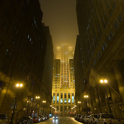 Looking south down LaSalle St on a foggy night, the Board of Trade building dominates the scene on this late night in Chicago's Loop District.