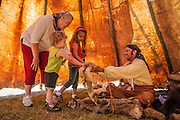 Lewis & Clark Honor Guard member Darian Kath showing animal pelts to visitors in his tepee at the encampment during the annual Lewis & Clark Festival at the Lewis and Clark National Historic Trail Interpretive Center in Great Falls, Montana.