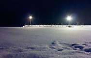 .Snow falling Warner Park boat launch, Madison, Wisconsin.