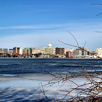 Madison Skyline Across Partially Frozen Lake Monona in Madison, Wisconsin<br /> While drive through Madison, Wisconsin, something may sound vaguely familiar. Washington, Franklin, Hamilton, Pierce and 35 other streets were named after the U.S. Constitution signers. The city&rsquo;s name comes from James Madison. He was the Father of the Constitution and also the fourth U.S. President. He died a few months before James Doty lobbied legislators in 1836 to designate his vacant land as the capital of the new Wisconsin Territory in exchange for honoring these founding fathers. The result is this gorgeous skyline from across the partially frozen Lake Monona.