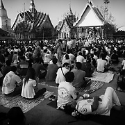 """Devotees attend the annual """"Wai Kru"""" tattoo festival at Wat Bang Pra in Nakhon Chasi, Thailand Saturday, March 23, 2013.  Devotees attend the one day event to have their """"Sak Yant"""" religious tattoos energized by Buddhist monks and tattoo masters."""