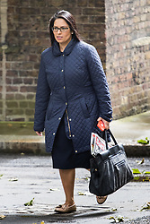 Downing Street, London, June 14th 2016. Employment Minister Priti Patel, with a copy of the Sun, its headline proclaiming they back the Leave campaign, arrives at 10 Downing Street to attend the weekly cabinet meeting.