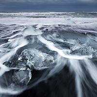 Iceland, Skaftafell National Park, Icebergs from Vatnajokull Glacier in waves from North Atlantic Ocean at Jokulsarlon