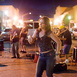 090812       Brian Leddy.Sue Cote dances in the street to the sounds of Black Mountain Band.