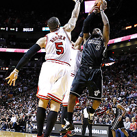 29 January 2012: Miami Heat small forward LeBron James (6) takes a jumpshot over Chicago Bulls power forward Carlos Boozer (5) during the Miami Heat 97-93 victory over the Chicago Bulls at the AmericanAirlines Arena, Miami, Florida, USA.