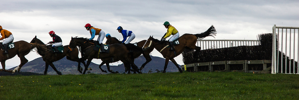 Mosshouses, Lauder, Scottish Borders, UK. 2nd May, 2015. Point to Point racehorses and jockey's competing in the Lauderdale Point to Point racing at the scenic course of Mosshouses with the landmark of the Eildon Hills in the background.