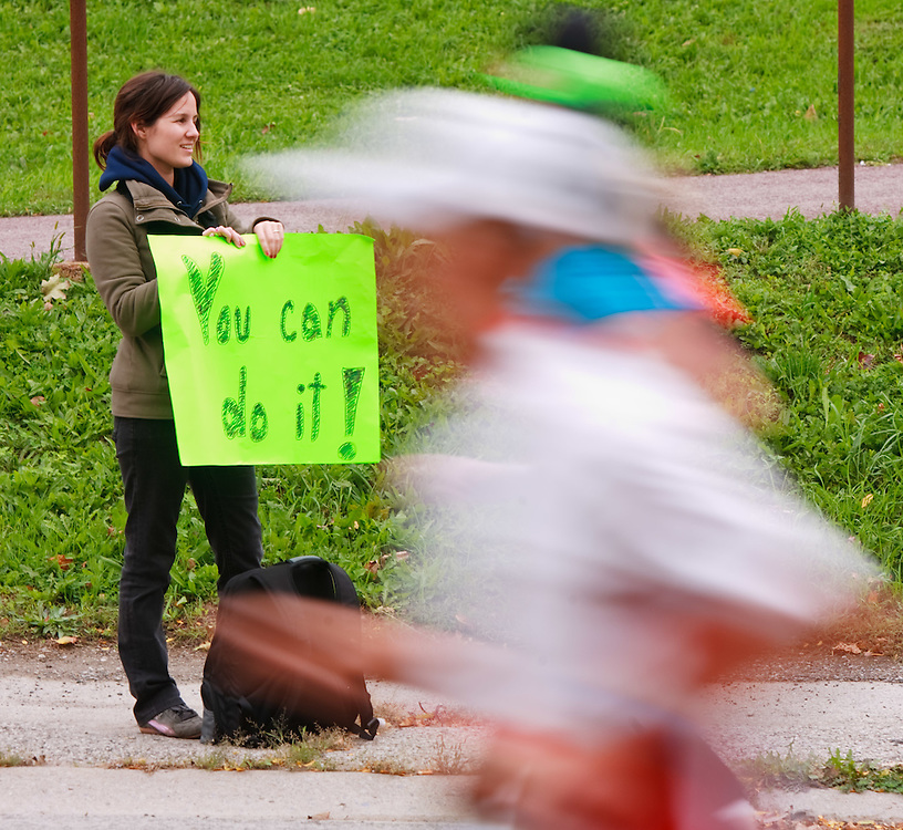 Toronto, Ontario ---11-10-16--- A supporter stands along the course cheering on runners during the Scotiabank Toronto Waterfront Marathon, October 16, 2011.<br /> GEOFF ROBINS Mundo Sport Images