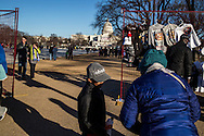 People walk around the National Mall ahead of Monday's inauguration of President Barack Obama on Sunday, January 20, 2013 in Washington, DC.