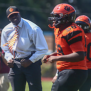 Tigers head coach Preston Brown, LEFT, celebrates on the side lines during a non-conference game between The Woodrow Wilson Tigers and The Northern Burlington Greyhounds Saturday, Sept. 17, 2016, at Mike Rozier Stadium in Camden, NJ.<br />