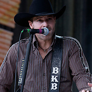 September 7, 2003; KEITH BURNS of TRICK PONY performing at Farm Aid, 2003, in Columbus, Ohio. Photo by Bryan Rinnert/3Sight Photography