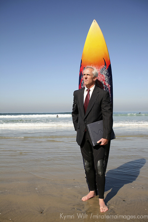 "From ""The Green Executive"" photo series, all about a successful CEO who surfs and makes a conscious effort to care for the environment.  He's an alternative commuter, board director, and gives a whole new meaning to ""wetsuit"". He's a real great boss who hires tele-commuters and flex-hour employees. He re-defines the stereotypical surfer of today. He speaks for and to the green demographic of environmental awareness, alternative commuting, healthy work/play balance, businesses going green, and ""do what you love, love what you do.""  And you can feel good about licensing this image too -a  portion of the proceeds will be donated to Surfrider Foundation."