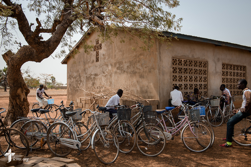 Church members gather with their motorcycles outside the Lutheran Church of Togo in Mire on Sunday, Feb. 12, 2017, in Mire, Togo. LCMS Communications/Erik M. Lunsford