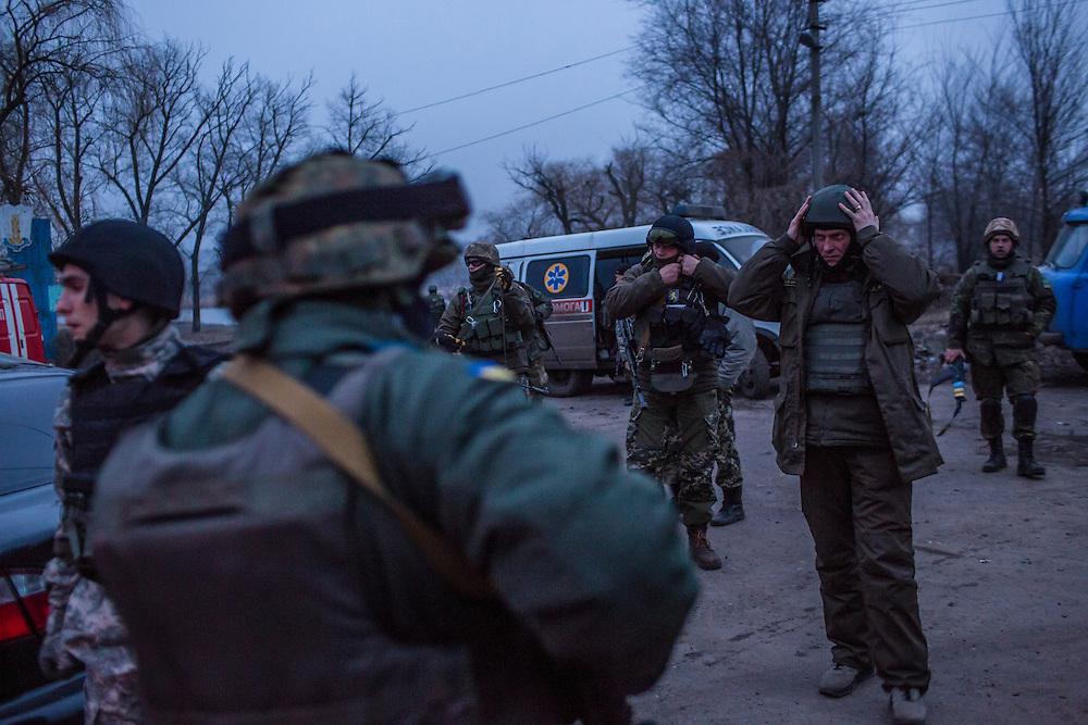 ARTEMIVSK, UKRAINE - FEBRUARY 14: Ukrainian fighters arrive at the scene of an artillery strike on February 14, 2015 in Artemivsk, Ukraine. A ceasefire between Ukrainian forces and pro-Russian rebels is scheduled to go into effect at midnight. (Photo by Brendan Hoffman/Getty Images) *** Local Caption ***