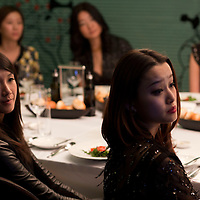 """BEIJING, DECEMBER-15 :  Attendees of  Sara Jane Ho's etiquette listen to an introduction of European """" manners"""".  In 2013 the 27- year -old Harvard Business School graduate will start  Institute Sarita, a boutique finishing school offering courses in Mandarin for high prices . Ho plans  to teach affluent Chinese the ''importance of being finished'' . Ho learnt her skills at Institut Villa Pierrefeu, Switzerland's last traditional finishing school, where a six-week course covering skills including flower arranging, hostessing and table-setting costs around $20,000."""