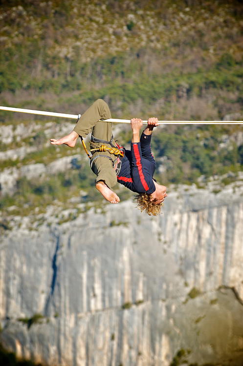 Swiss highliner Simon Egger catches another scary fall on a 40m highline, 200m high, rigged in the Sordidon sector of Verdon Gorges, France...2012 © Pedro Pimentel