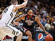 SHOT 1/21/12 6:46:44 PM - Arizona's Jesse Perry #33 drives the lane in front of Colorado's Shane Harris-Tunks #15 during their PAC 12 regular season men's basketball game at the Coors Events Center in Boulder, Co. Colorado won the game 64-63..(Photo by Marc Piscotty / © 2012)