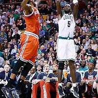 21 December 2012: Boston Celtics power forward Kevin Garnett (5) takes a jumpshot over Milwaukee Bucks center Larry Sanders (8) during the Milwaukee Bucks 99-94 overtime victory over the Boston Celtics at the TD Garden, Boston, Massachusetts, USA.