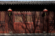 Asia, China, Hubei province.  Doors of exhibition hall with pictures of martial arts postures on Wudang moutain (Wudang-san), a World Heritage mountain with many Taoist monasteries.