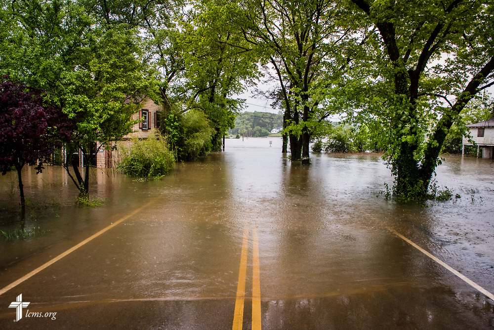 A flooded road and homes on Wednesday, May 4, 2017, in Eureka, Mo. LCMS Communications/Erik M. Lunsford