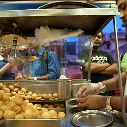 A vendor at a street food stall in south Delhi prepares golgappa ( pani puri) a favorite street food snack, as customers are waiting to be served. Panipuri, or Pani puri, is a snack synonymous with the beaches of Mumbai. However, it is also very popular in all other parts of India known by many names like golgappa (plural golguppe) in North India, Foochka (Puchka) in West Bengal and Gupchup in some central parts of India like Hyderabad.