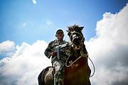 A BPU ( Border Patrol Unit ) officer comes back from a patrol on his horse in Belulikleten. @ UNMIT/Martine Perret. 20 June 2007