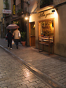 On a rainy night a couple pass by one of the many restaurants in Logrono in Rioja. The town was full of many small restaurants and tapas bars.