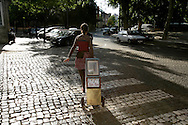 """One of the street animators carrying her mobile library. """"Jazz ao Centro"""" jazz festival is held twice a year in portuguese town of Coimbra."""