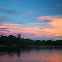 South America, Peru, Amazon. Sunset of the Amazon.