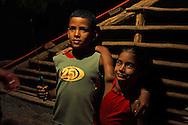 Boy and girl with a knife at a farm. Vega Yumuri, near La Maquina, Guantanamo Province, Cuba.