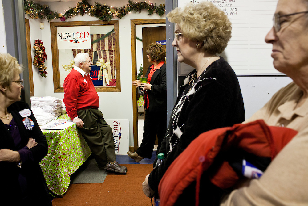 People talk as they wait for Republican presidential candidate Newt Gingrich to arrive for a rally at his campaign office on Monday, January 2, 2012 in Davenport, IA.
