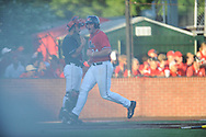 Mississippi's Sikes Orvis (24) scores against Louisiana-Lafayette's Michael Strentz (11) in an NCAA Super Regional game in Lafayette, La. on Saturday, June 7, 2014.    Louisiana-Lafayette won 9-5.