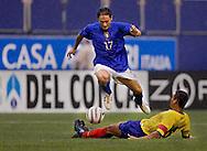 Italy's Fabio Quagliarella goes over Ecuador's Carlos Castro. (Photo by Robert Falcetti). .
