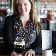 """SHOT 3/25/14 3:02:10 PM - Euclid Hall bar manager Jessica Cann of Denver, Co. prepares a """"Return of the Naughty Girl Scout"""", a beer cocktail that mixes chocolate liquer, coffee liqueur, peppermint schnapps, and Left Hand Nitro Milk Stout beer $11. (Photo by Marc Piscotty / © 2014)"""