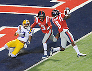 Mississippi defensive back Chief Brown (8) intercepts a pass intended for LSU's Odell Beckham Jr. (3) as Mississippi defensive back Charles Sawyer (3) also defends at Vaught-Hemingway Stadium in Oxford, Miss. on Saturday, October 19, 2013. (AP Photo/Oxford Eagle, Bruce Newman)