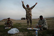 Iraqi Army 1st Lt. Ahmed Hessen from the 4th Division 2nd Brigade 1st Battalion tells his soldiers to hurry up so they can start to search the air field during Operation Aerodrome in the Al Muradia village Iraq, Mar., 12, 2007. Soldiers are assigned to 4th Platoon, Delta Company, 2nd Battalion, 27th Infantry Regiment, 3rd Brigade Combat Team, 25th Infantry Division, Schofield Barracks, Hawaii. Operation Aerodrome is a search of the village and near by airfield for high target items.