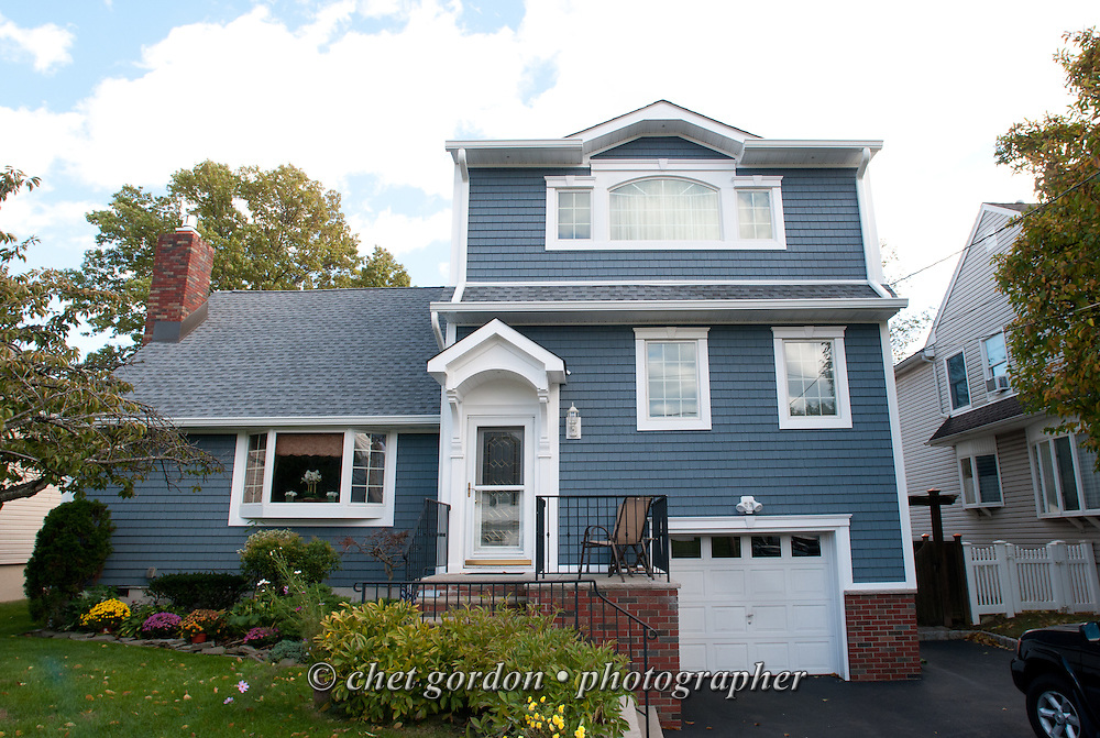 General view of Craig Furer's Cranford, NJ home on Sunday, October 23, 2016. Furer and his wife Jen hired Magnolia Home Remodeling Group to complete a full exterior makeover. The company replaced the siding with shake and clapboard, added various architectural accents, replaced the roof, modified the roofline, built a front portico and replaced two windows. Craig spent a lot of time researching this project before it began and is thrilled with the overall result.  © Chet Gordon for Angie's List