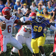 Delaware Defensive tackle VINCE HOLLERMAN (59) penetrate into the backfield as Delaware State Quarterback CORY MURPHY (6) attempts to throw a pass in the pocket during a Week 2 NCAA football game against Delaware State University. <br /> <br /> Delaware defeated Defeated Delaware State 42-21 Saturday. Sept Sept. 07, 2013 in Newark Delaware.