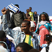 Ethiopian Falash Mura arrive at the Ben Gurion airport, outside Tel Aviv on August 28, 2013. Some 450 new immigrants from Ethiopia were brought to Israel as part of the 'Operation Wings of Dove ' operation launched three years agoby the Jewish Agency to bring the remaining Falash Mura – Ethiopian Jews whose ancestors were forced to convert to Christianity - to Israel.  Photo by Oren Nahshon