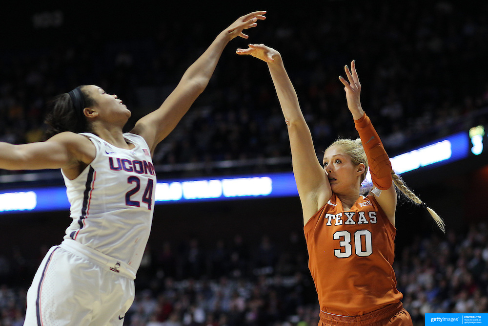 UNCASVILLE, CONNECTICUT- DECEMBER 4:  Khaleann Caron-Goudreau #30 of the Texas Longhorns shoots while challenged by Napheesa Collier #24 of the Connecticut Huskies in action during the UConn Huskies Vs Texas Longhorns, NCAA Women's Basketball game in the Jimmy V Classic on December 4th, 2016 at the Mohegan Sun Arena, Uncasville, Connecticut. (Photo by Tim Clayton/Corbis via Getty Images)